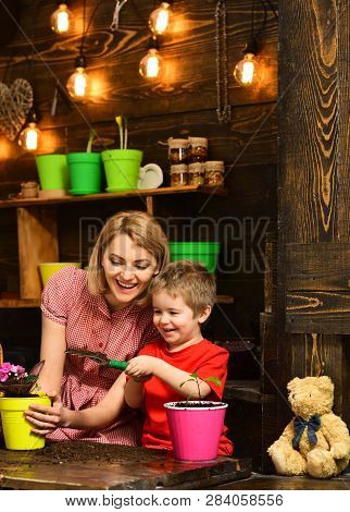 Eco Concept. Eco And Ecology. Be Eco Friendly And Go Green. Little Child Help Mother Planting Flower