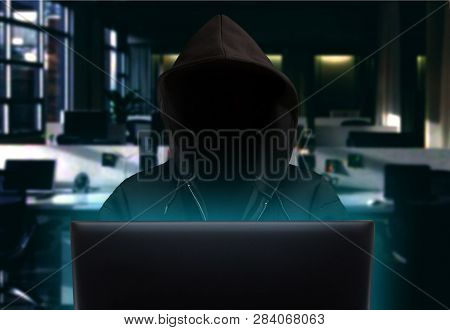 Hacker Stealing Data In The Office At Night