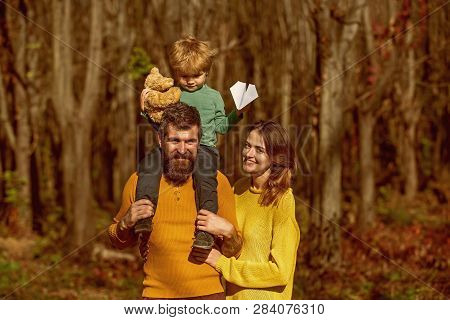 Wife And Husband With Little Baby Son Enjoy Sunny Day In Park, Genetic Relationship. Family Relation