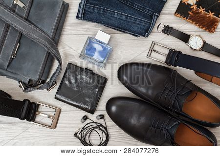 Shoulder Bag, Pair Of Black Leather Men's Shoes, Belts For Men, Jeans And Accessories.