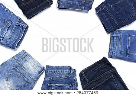 Frame Of Different Blue Jeans Isolated On White Background Top View Flat Lay. Detail Of Nice Blue Je