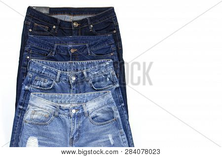 Set Of Different Blue Jeans Isolated On White Background Top View Flat Lay. Detail Of Nice Blue Jean
