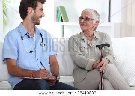 Senior woman talking to a young medic