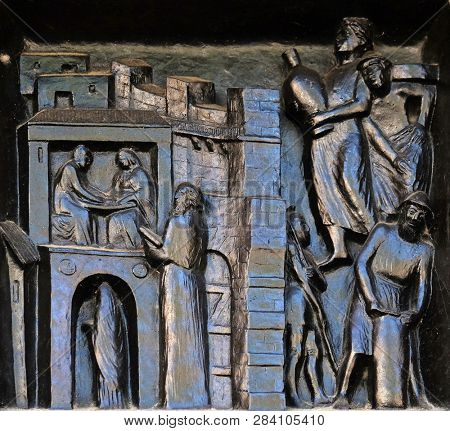 ZURICH, SWITZERLAND - JUNE 23, 2018: You shall sanctify the sabbath day - Nehemiah will not let the traders into the city on the sabbath day, relief on the door of the Grossmunster church in Zurch
