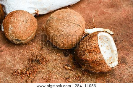 Peeled Ripe Coconut Half Cut On Ground / Tropical Fruits Natural For Coconut Milk