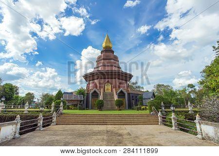 Sam Than Choa Khun Pagoda With Thai Language Post In Wat Pai Lom, Trad Province, Thailand.