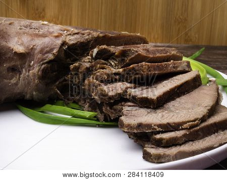 Raw Five Pork Or Beef Tongues With Green Onion, On Wooden Background Gourment Food Conception, Selec