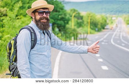 Picking Up Hitchhikers. Stop Car. Man Try Stop Car Thumb Up. Hitchhiking One Of Cheapest Ways Travel