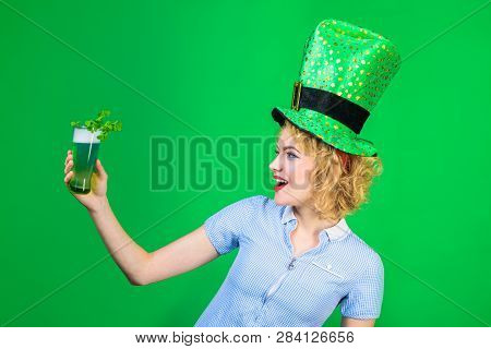 St Patrick's Day. Green Top Hat. Saint Patrick. Woman In Top Hat Holds Glass With Green Beer. Leprec