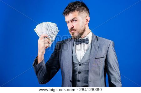 Investing Money. Rich Businessman With Us Dollars Banknotes. Currency Broker With Bundle Of Money. M