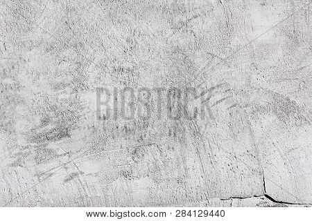 White And Gray Dissimilar Abstract Textured Plaster On The Wall