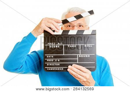 Man as a director looks through an open movie flap