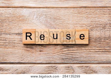 Reuse Word Written On Wood Block. Reuse Text On Wooden Table For Your Desing, Concept