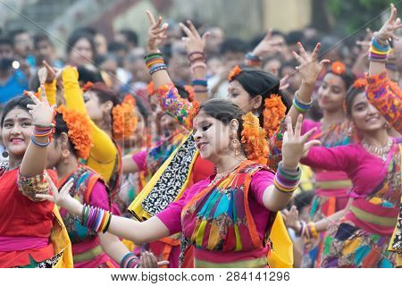 Kolkata, India - March 1, 2018 : Dancing Poses Of Girl Dancers , Dressed In Bright Red Coloured Sari