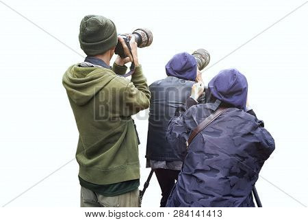 Professional Wildlife Photographer On White Background ,photographer Takes A Picture With Profession