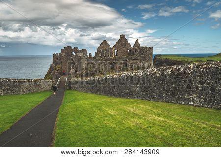 Tourist walking to main entrance  castle.