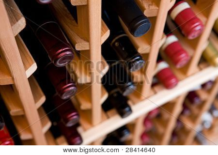Looking Down On Two Rows of Wine Bottles
