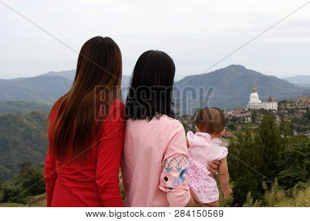 Back View Of Three Generations Female Looking At Mountain On The Phu Tub Berk In Petchabun Thailand.