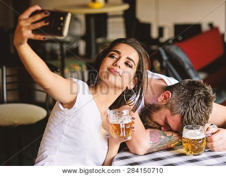 Take Selfie To Remember Great Event. He Appears Too Weak For Her. Woman Making Fun Of Drunk Friend.