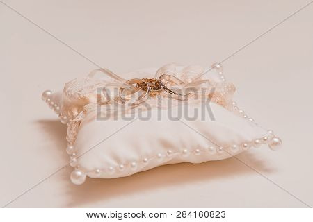 Silk Pillow Embroidered With Pearls For Wedding Rings Gently Peach Color Close-up