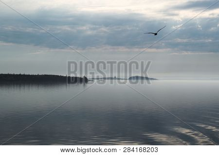 Northern Morning On The Lake. Islands On Lake Onega In The Morning Haze. The Sun Is Hidden Behind Th