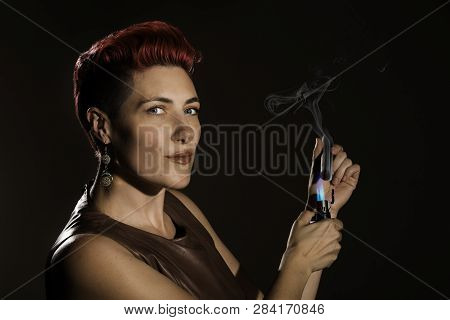 Modern Woman With Fuchsia Hair Lighting A Cigar