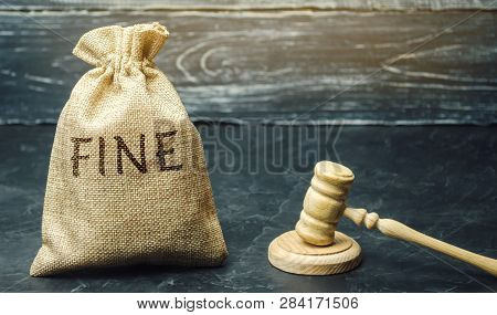 Money Bag With The Word Fine And The Judge's Hammer. Penalty As A Punishment For A Crime And Offense