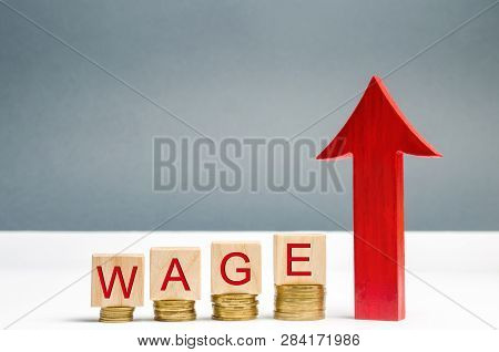Wooden Blocks With Coins And The Word Wage And Up Arrow. Increase Of Salary. Wage Rates. Career Grow