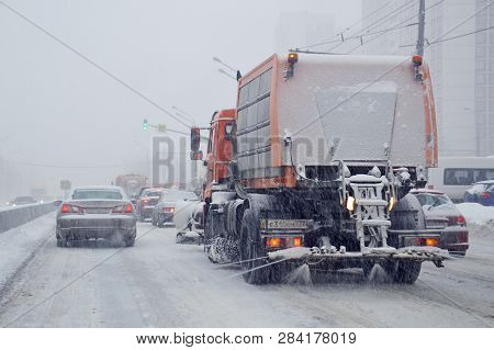 Moscow, Russia - January, 2019: A Utility Vehicle Machine Scatters Reagent On A Carriageway In A Sno