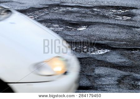 Roadway. It Has A Lot Of Holes That Need Repair. Have A Car. Toning