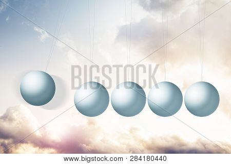 Newtons Cradle On Fantasy Background With Colorful Clouds