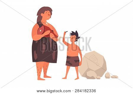 A Primitive Woman, Dressed In Her Skin, Holds Meat And Talks To Her Child. The Life Of Neanderthals