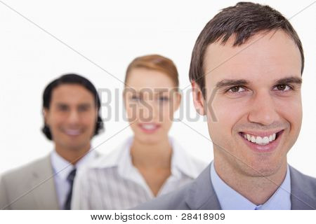 Smiling businesspartner lined up against a white background