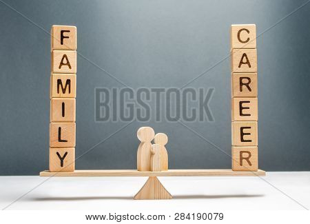 Family Figures Stand On Scales Between Career And Family. Conceptual Balance In Life, Increasing Att