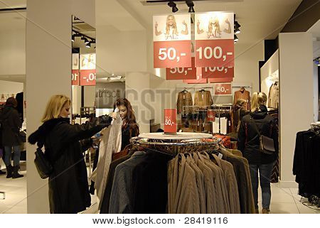 DENMARK / COPENHAGEN _ Female consumers in earch for new year sale at various textile and fashion stores to boost danish economy 2012 today on 2 jan. 2012