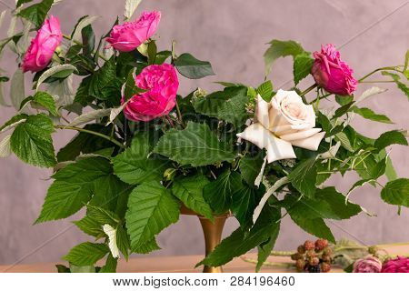 The Workplace Of The Florist To Work. Side View. Making Floral Decorations. Flowers On A Old Wooden