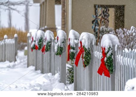 White Picket Fence With Wreaths In Daybreak Utah