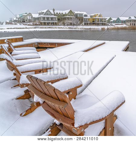Winter In Daybreak Utah With Chairs On A Lake Deck