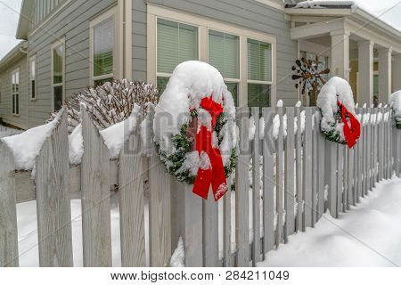 Winter Landscape With Wreath On A Picket Fence