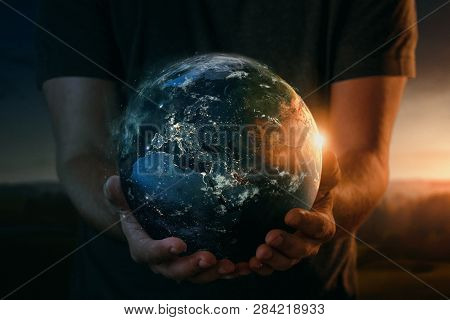 Planet Earth At Sunrise In Human Hands