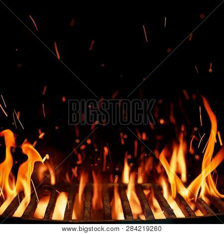 Empty Grill, Barbeque Grid With Fire Isolated On Black Background With Copy Space