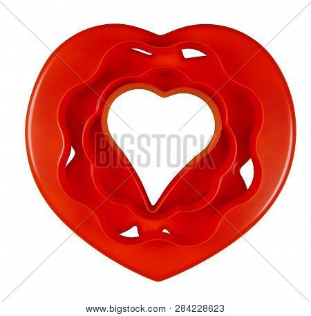 Set Of Red Silicone Molds Isolated On White. Clipping Path Included.