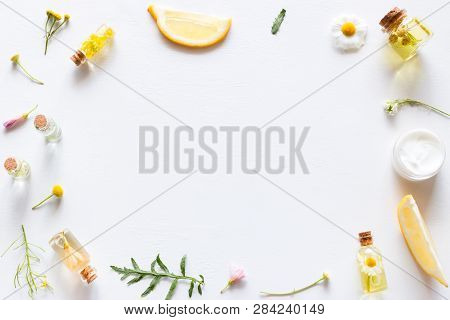 Background With Cosmetic Products For Face And Body Care, Leaves And Wildflowers Mockup