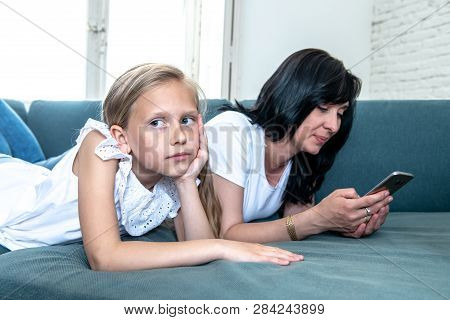 Internet Addicted Mum Using Her Smart Phone Ignoring Her Sad Lonely Child