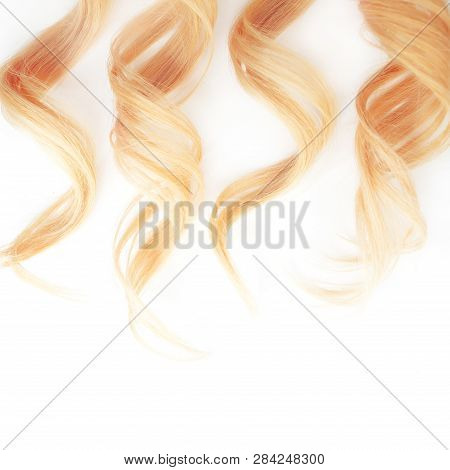 Golden Curls Hair Isolated On White Background. Strand Of Blonde Or Red Hair, Hair Care, Concept