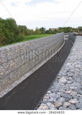 Tall gabion wall