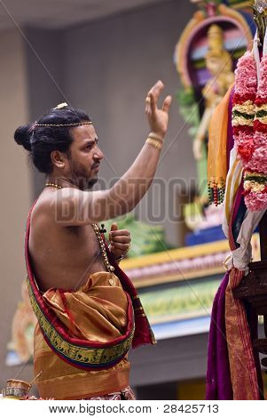 Hindu Priest Performs The Pooja For The Hindu Devotees During The Chariot Festival At Richmomd Hill