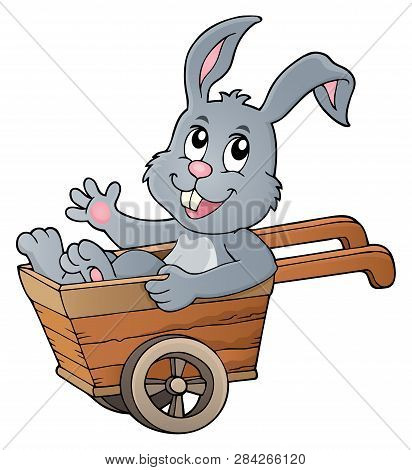 Easter Bunny In Wheelbarrow Image 1 - Eps10 Vector Picture Illustration.