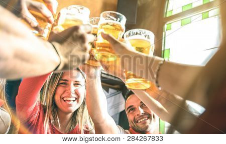 Friends Drinking And Toasting Beer At Brewery Bar Restaurant - Friendship Concept On Young Millenial