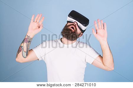 Man With Beard In Vr Glasses. Hipster On Busy Face Exploring Virtual Reality With Modern Gadget. Vr